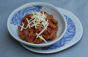 Beans + Grains = hearty vegan chili!