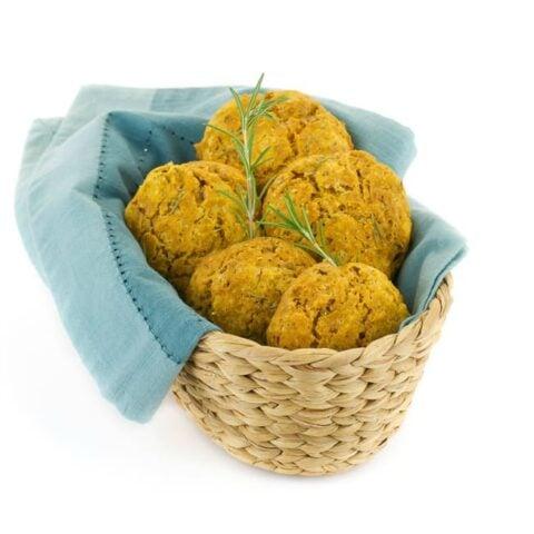 Vegan Pumpkin Drop Biscuits in a Basket with blue napkin