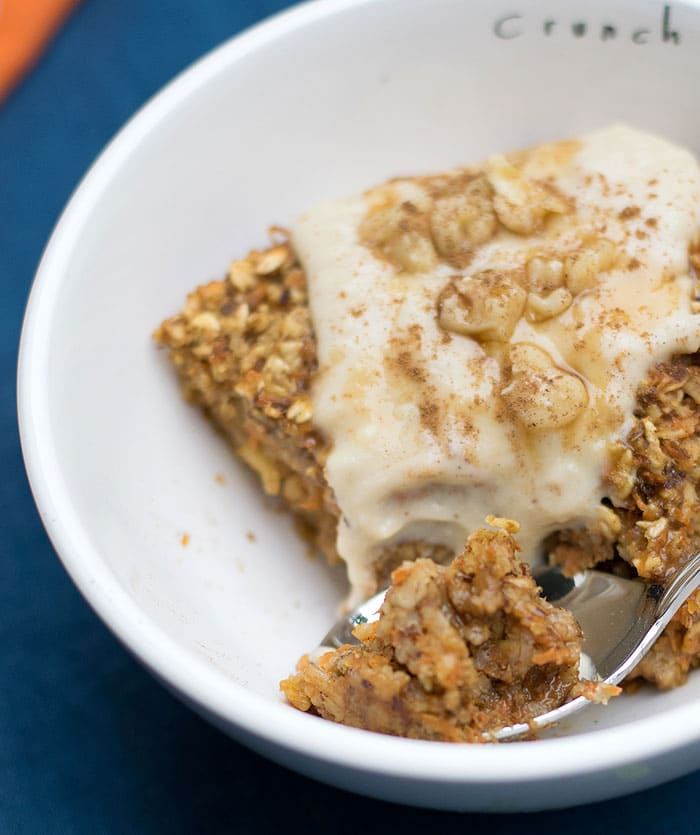 "Vegan Baked Orange Carrot Cake Oatmeal topped with Vanilla Nancy's Organic Cultured Soy ""Icing"""