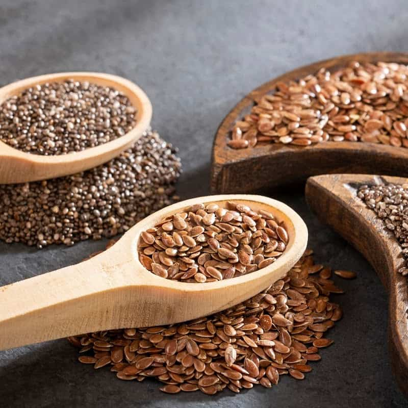 Whole flax seeds in a wooden spoon
