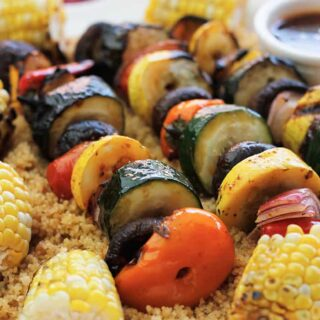 Vegan Harissa Grilled Veggie Kabobs with Corn Over Couscous