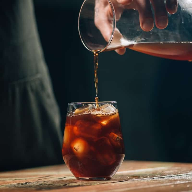 Cold brew coffee pouring over ice