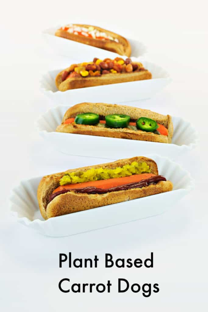 4 plant based carrot dogs on white background