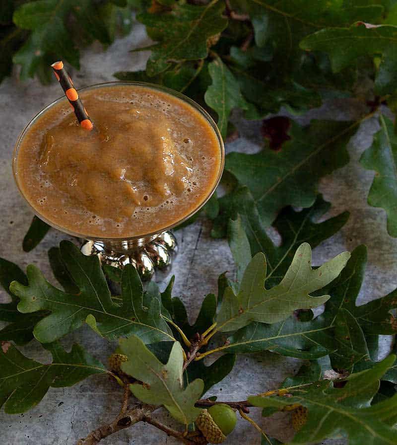 Frozen pumpkin spice coffee in pumpkin stemmed martini glass