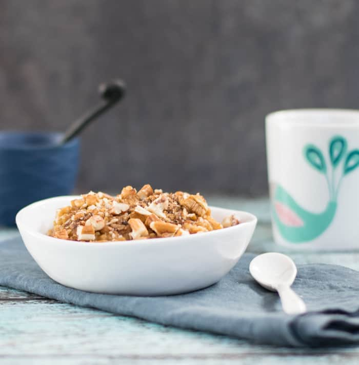 Vegan Slow Cooker Pumpkin Steel Cut Oats with a coffeecake topping in a white bowl