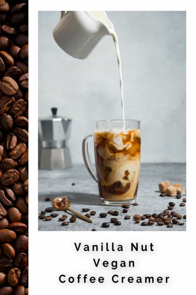 Creamer pouring into a glass mug of coffee with coffee beans scattered around it