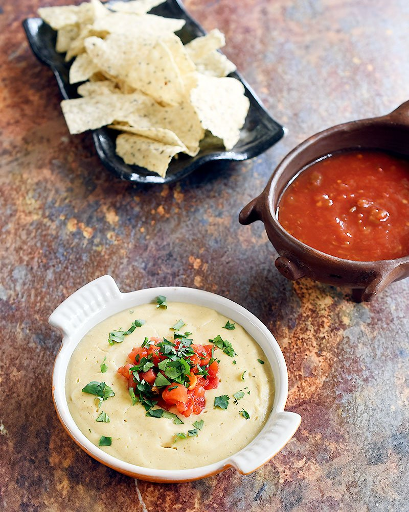 Oat Vegan Queso with a side of salsa and chips